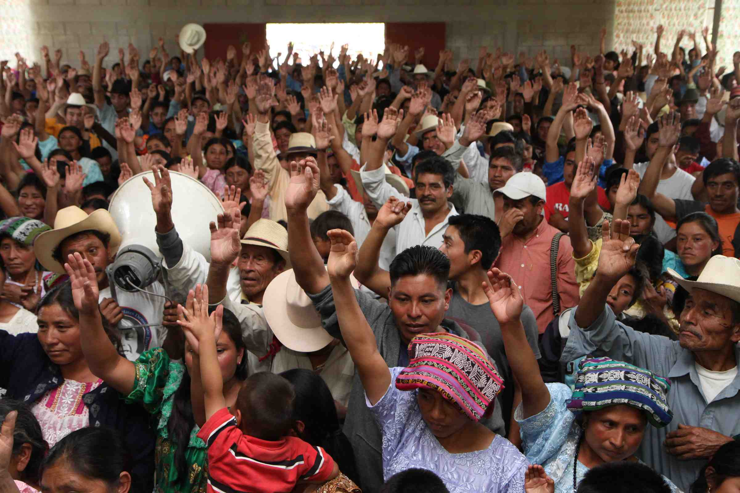 Residents of CantÛn Pajajxit I, II and III vote during the community consultation on the exploitation of natural resources. On a historic day, residents from the municipality of Santa Cruz del QuichÈ - one of Guatemala's most important hubs and the birthplace of the Maya K'iche' people - unanimously rejected the exploitation of natural goods and resources, in particular through mining and hydroelectric activities. Santa Cruz, Quiche, Guatemala. October 22, 2010.