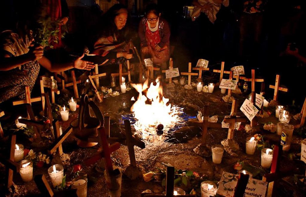 On March 21, people in Guatemala join the international day of action to denounce the massacre. Credit: Prensa Comunitaria