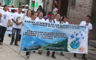 Members of JODVID march in 2016 during a commemoration to honor the lives of the martyrs who have been killed in the struggle to protect land.