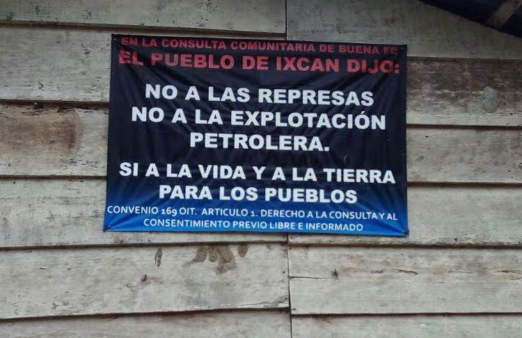 "A sign in Copal AA La Esperanza, Cobán, Alta Verapaz, one of the ACODET communities, reads: ""In the community consultation of good faith the people of Ixcán said: no to the dams, no to petroleum exploitation, yes to life and land for indigenous peoples. ILO Convention 169 Article 1: The right to consultation and free, prior, and informed consent."""