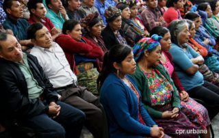 AJR members listening at a Guatemalan court
