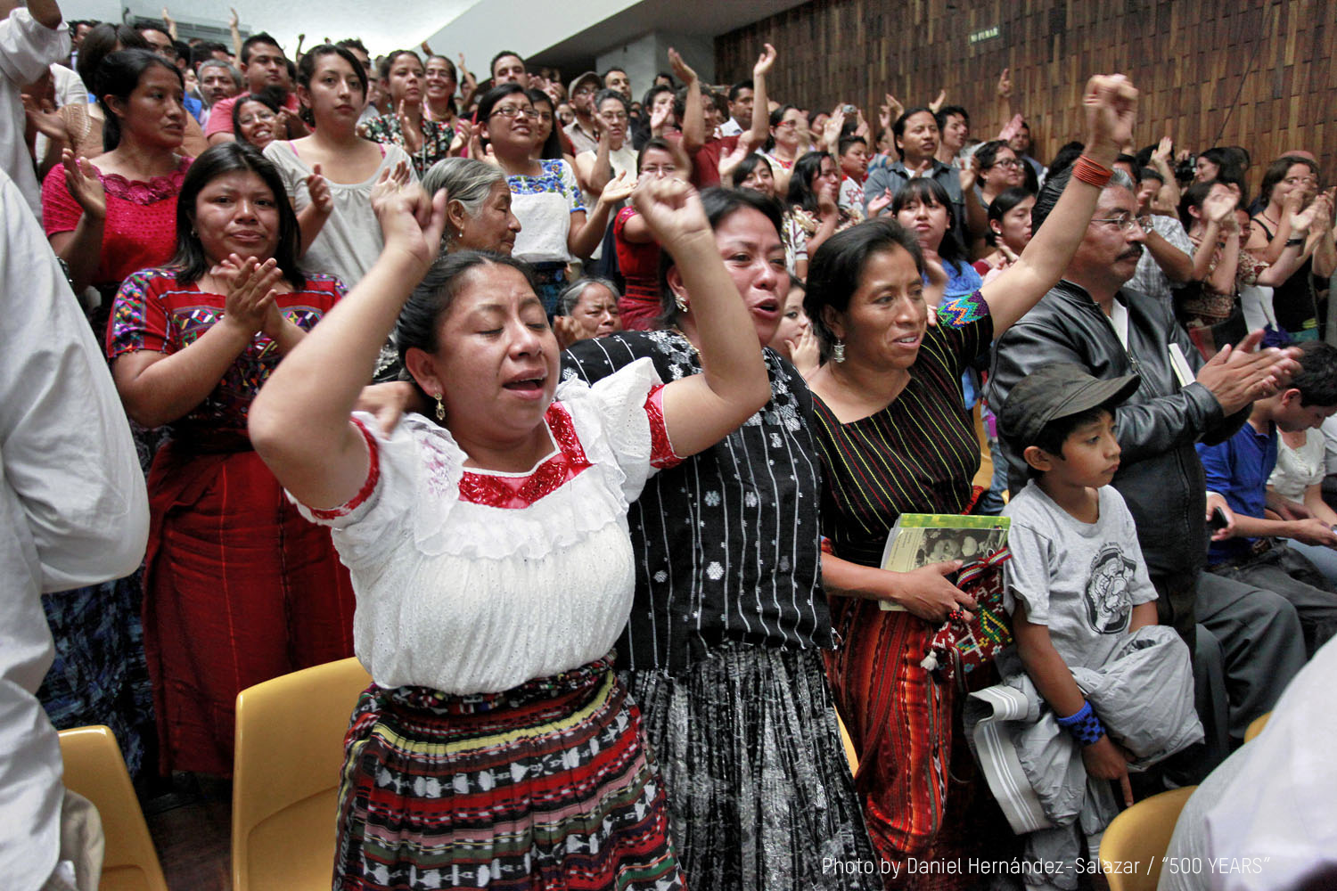People cheer after the judges announce a guilty verdict against Ríos Montt in 2013.