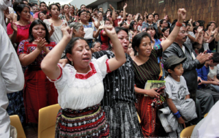 Mayan women cheering after the 2013 guilty verdict against Ríos Montt.