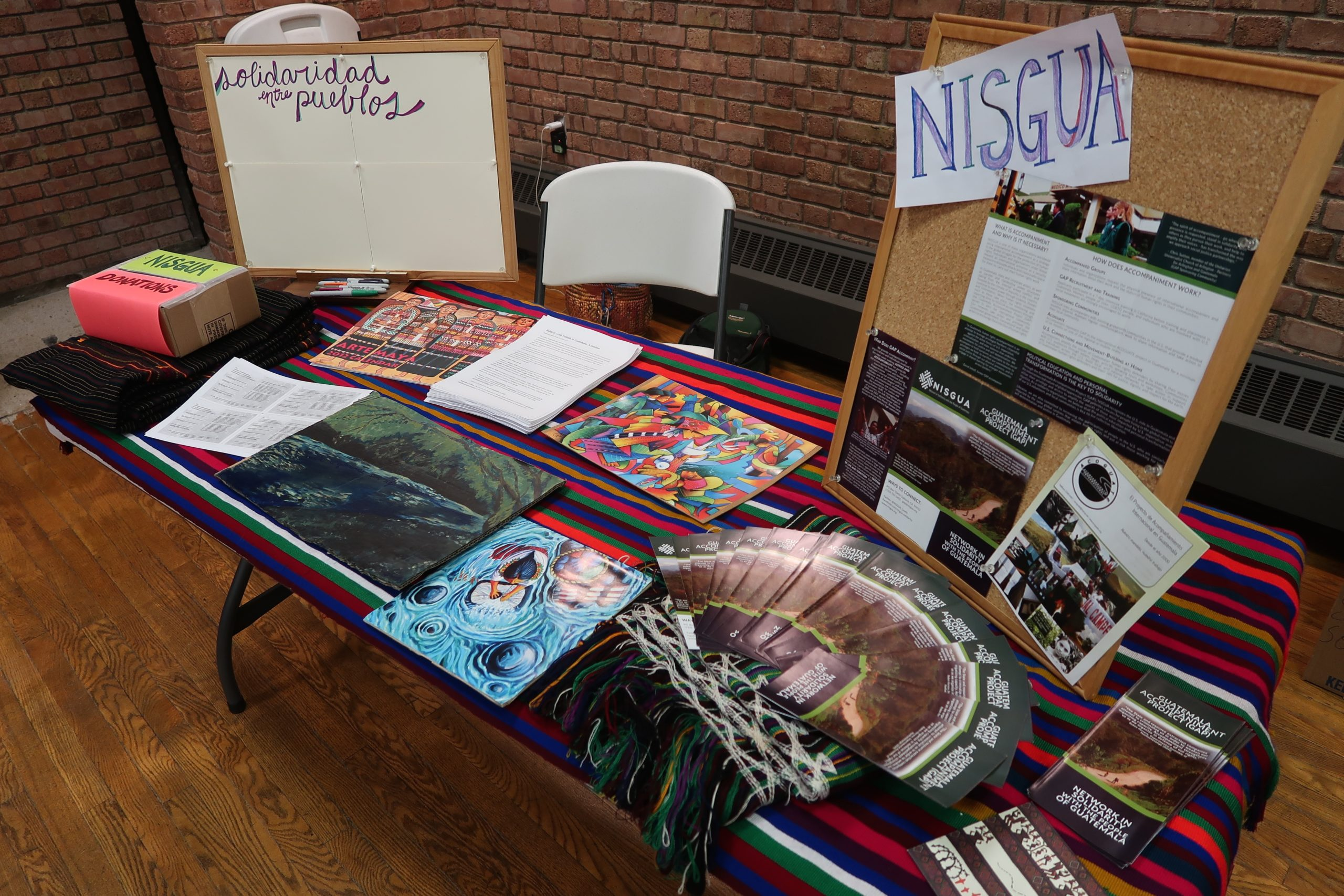 A photograph of a NISGUA table at an event.