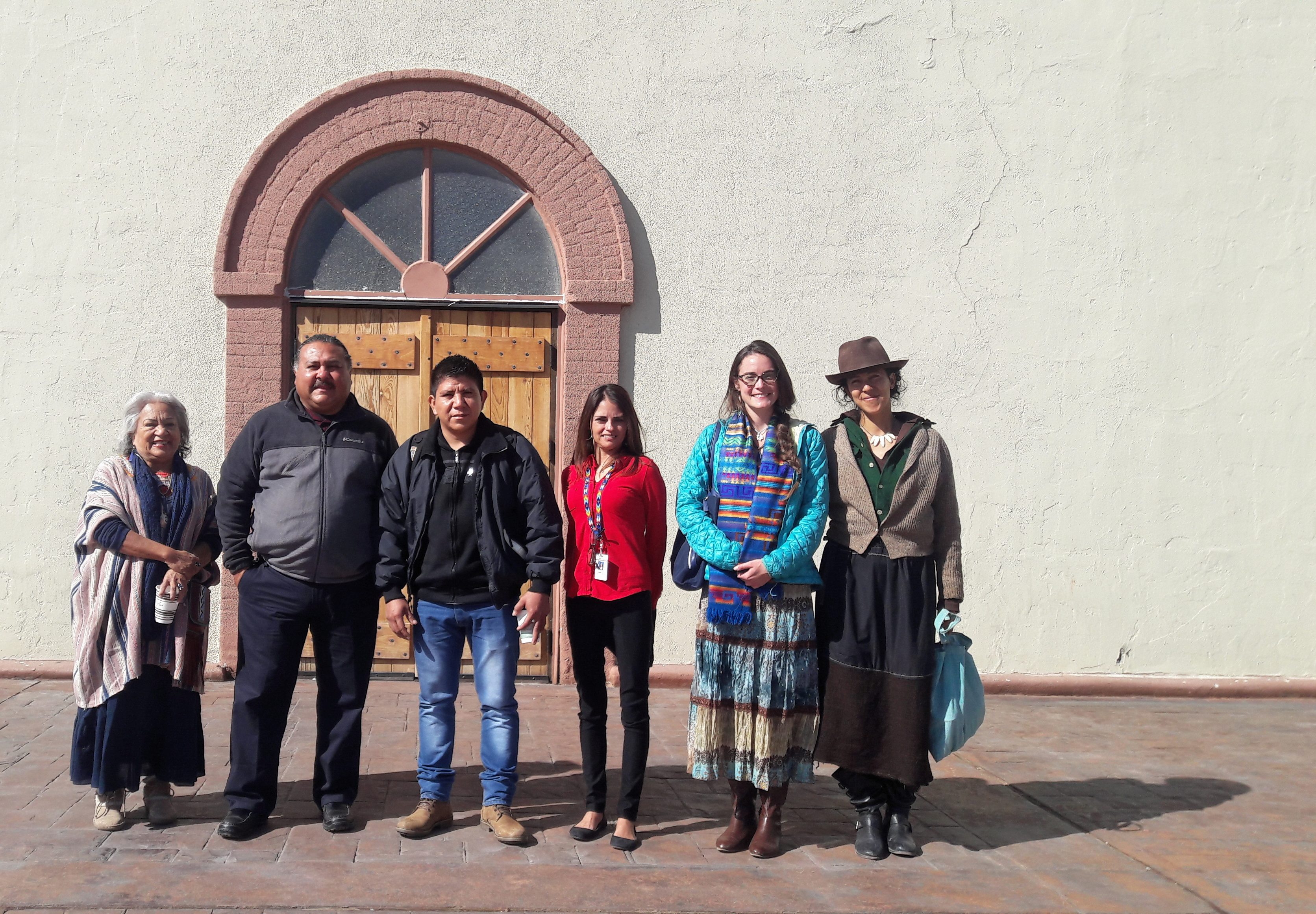 Representatives of Mexica, Tiwa, Maya Mam, Eastern Shoshone and Quechua descent stand in front of the Ysleta Mission, the original site of the Ysleta del Sur Pueblo community.
