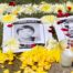 black and white pictures of guatemalan dessapeared are laying in the ground surrounded by flowers and candles