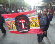 Martina Bar Sunun, first spokesperson for the board of the AJR, marches with a sign representing the AJR.