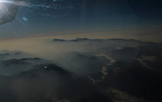 Delegate Buffy Charley captures mist-covered mountains on the flight to Guatemala City. Photo credit: Buffy Charley