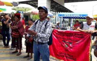"Three hundred community members organized by the ADH took over the Mesiilla check point on the Guatemala-Mexico border on August 9, protesting the ""third safe country"" agreement, systemic impunity & the invasion of their territorries by extractive industry. Photo Credit: Departamental Assembly of Peoples of Huehuetenango (ADH)"