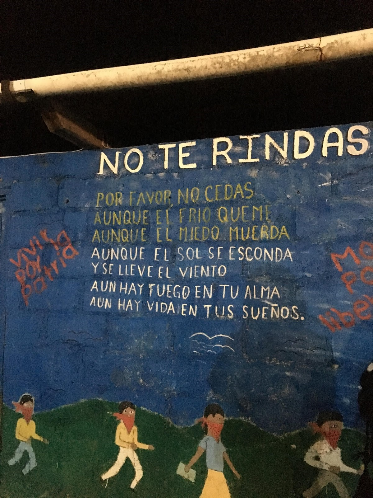 "Mural on Zapatista Territory of a poem titled ""No Te Rindas"", or ""Don't Give Up"""