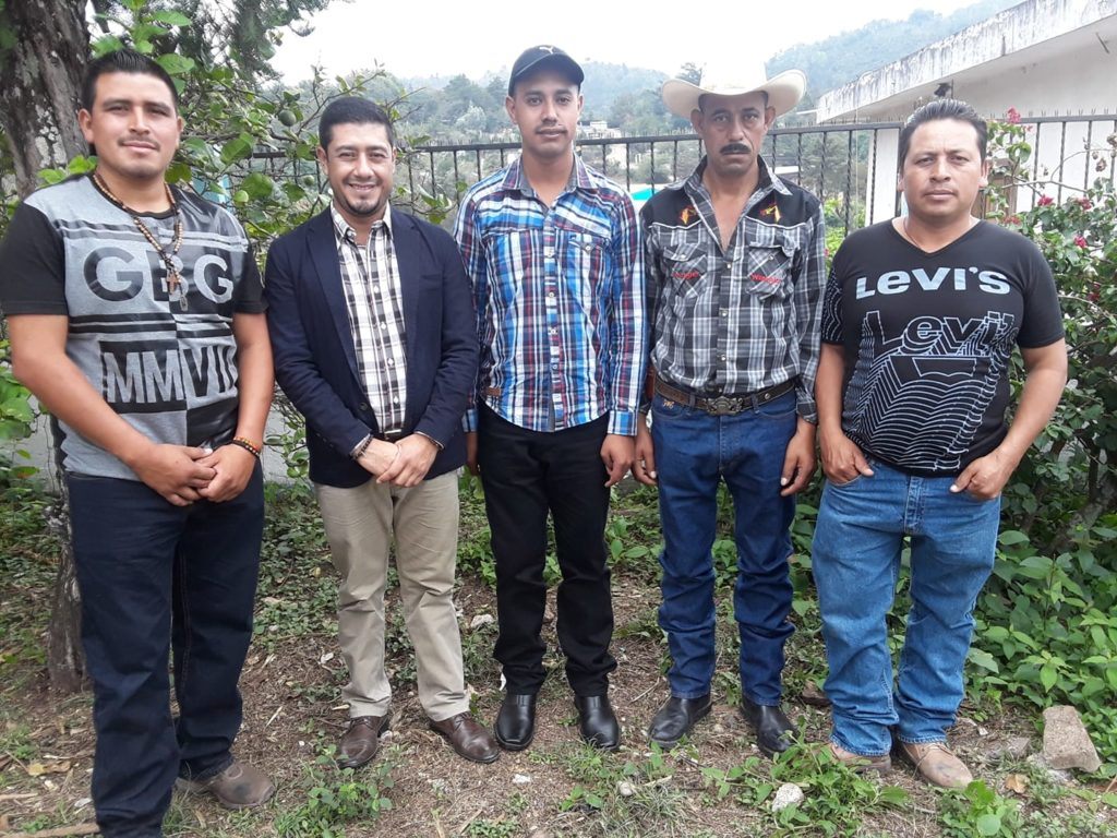 Quelvin Jiménez stands with Luis Fernando Garcia, Adolfo Garcia, Wilmer Pérez, and Misiel Alberto Martínez Sasvin, who survived an attack by Escobal mine private security in 2013. Quelvin represents the men as their lawyer as they seek justice.